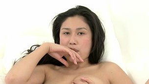 Alluring Asian hotty Ming caresses her perfect shaven pussy