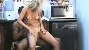 In the kitchen, a horny blonde housewife gets screwed hard in both holes
