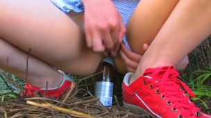 Nasty schoolgirl Beata came in the countryside to visit her grandparents during summer vacation. Beata forgot her toy at home and needs to use improvised bottle-dildo.