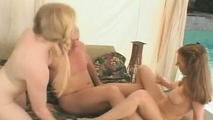 Slutty babes please each other's holes and take turns fucking a big rod