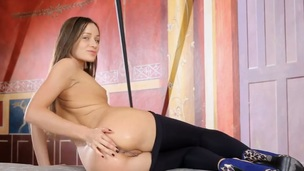 Brunette fucks herself in the asshole with toy