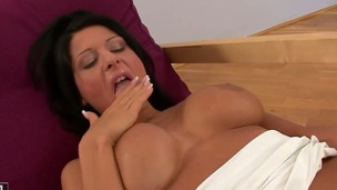 Brunette Alison Star with giant jugs kills time rubbing her honeypot