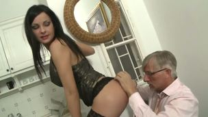 Abbie looks breathtaking in her dark lingerie, and more particularly, her torn dark stockings, which expose her lovely toes. Christoph noticed and, naturally, went right for them.