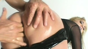 Soft on the eyes prostitute gets her holes oiled and fucked by cruel dudes