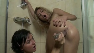 Hot young lesbians banging each other's holes with dildos in the shower