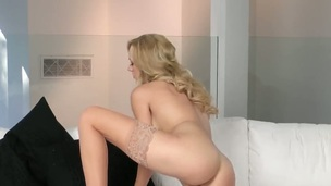 Brett Rossi with juicy breasts and hairless pussy spends time rubbing her muff