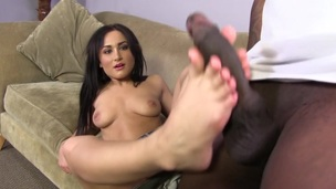Slut with small feet plays around with black cock and gets her toes jizzed